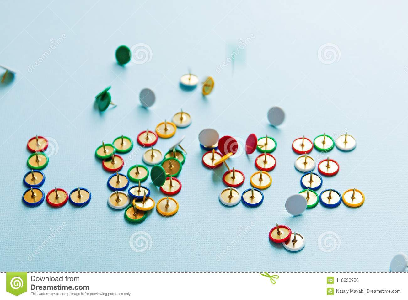 Broken word love from pins collection of stationery multicolored buttons, love theme