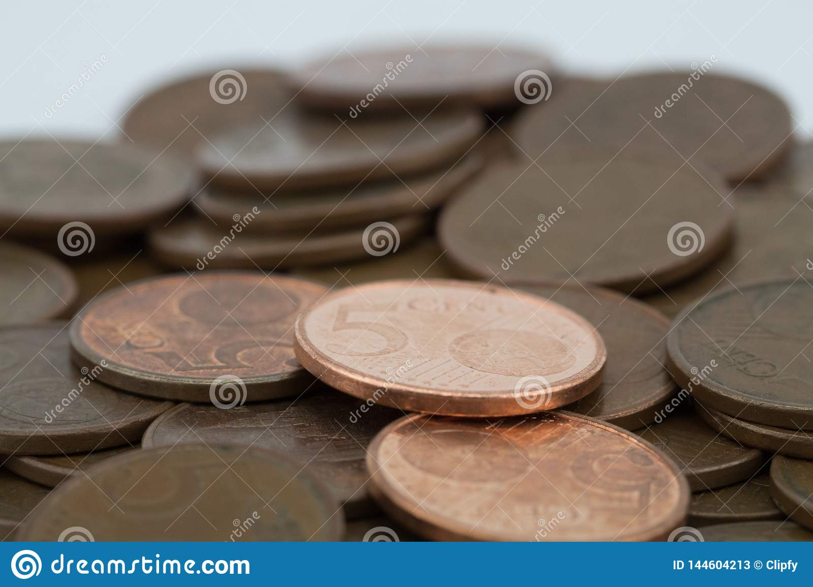 Bronze coins on white background. Coins of five euro cents. Savings