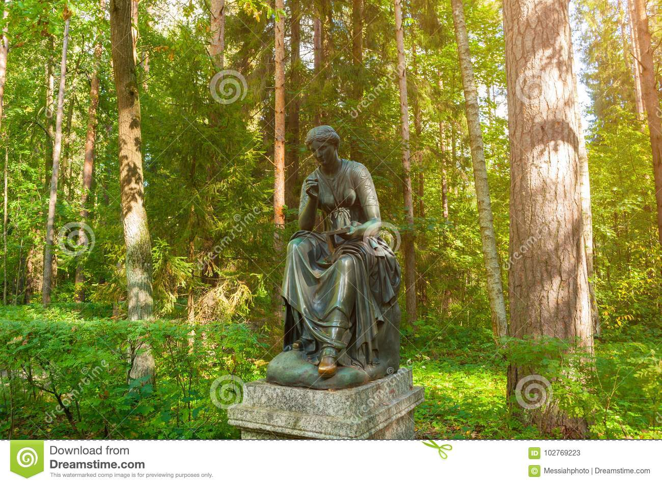Bronze sculpture of Calliope - the muse of epic poetry and knowledge. Old Silvia park in Pavlovsk, St Petersburg, Russia