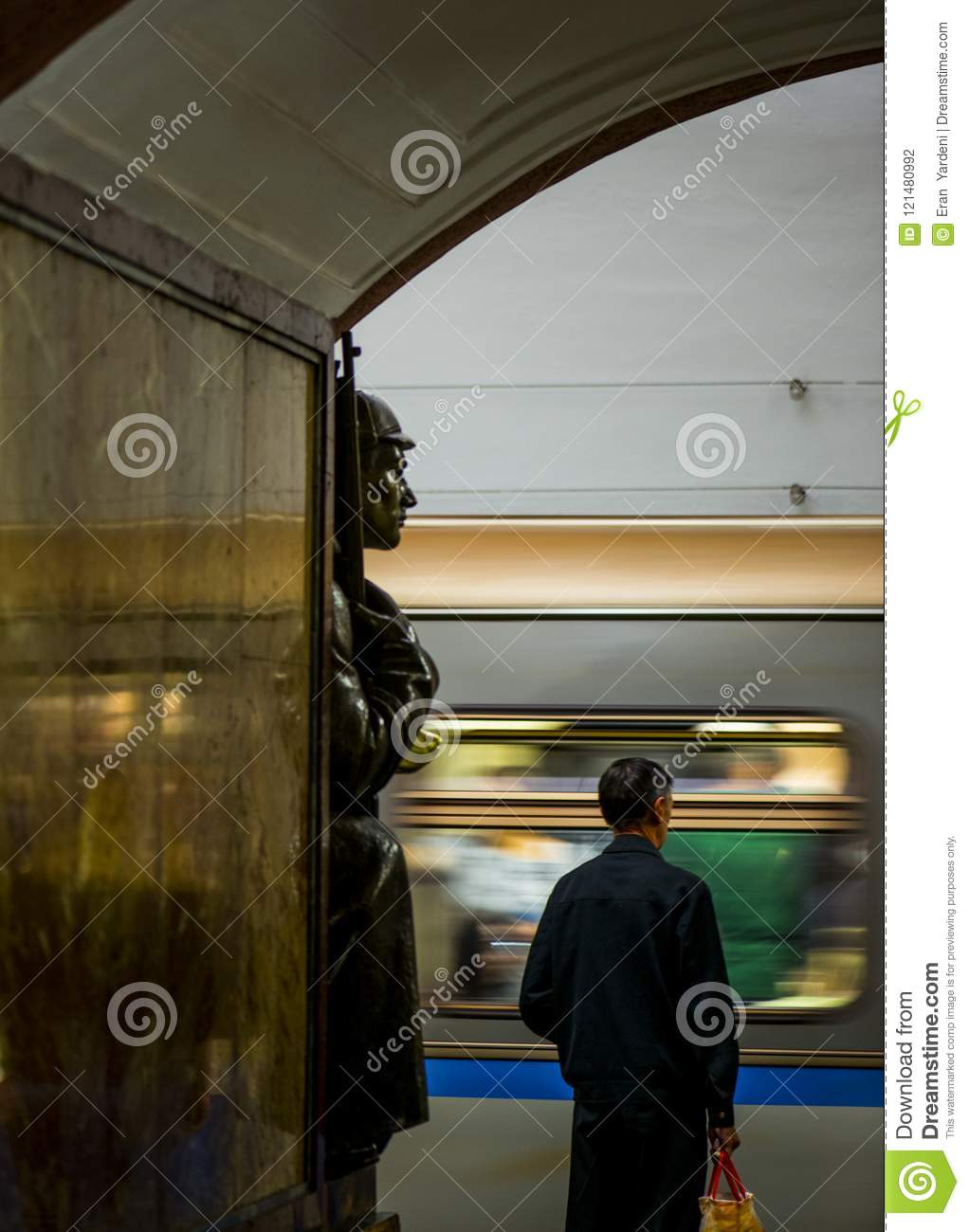 Bronze sculpture in the famous russian revolution metro station, moscow, russia