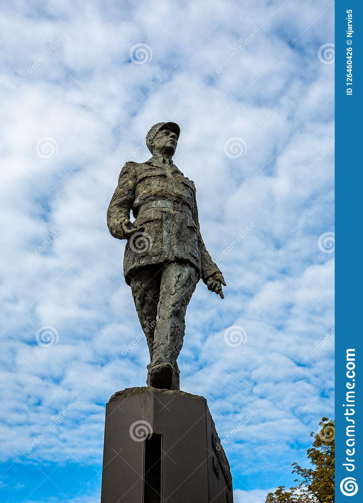 Bronze Statue of Charles de Gaulle against a blue sky in the Place Clemenceau in Paris