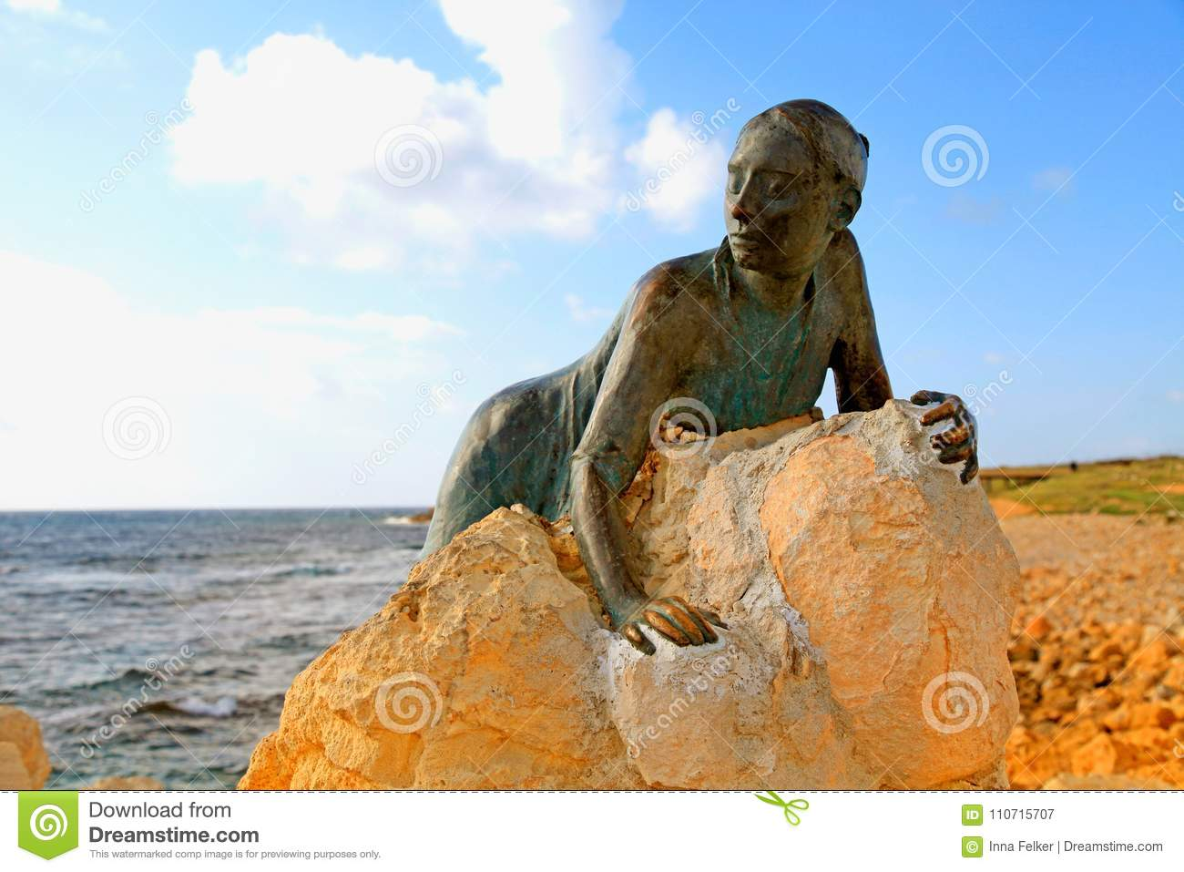 Bronze statue of woman called `Sol Alter` on a stone, Paphos, Cy