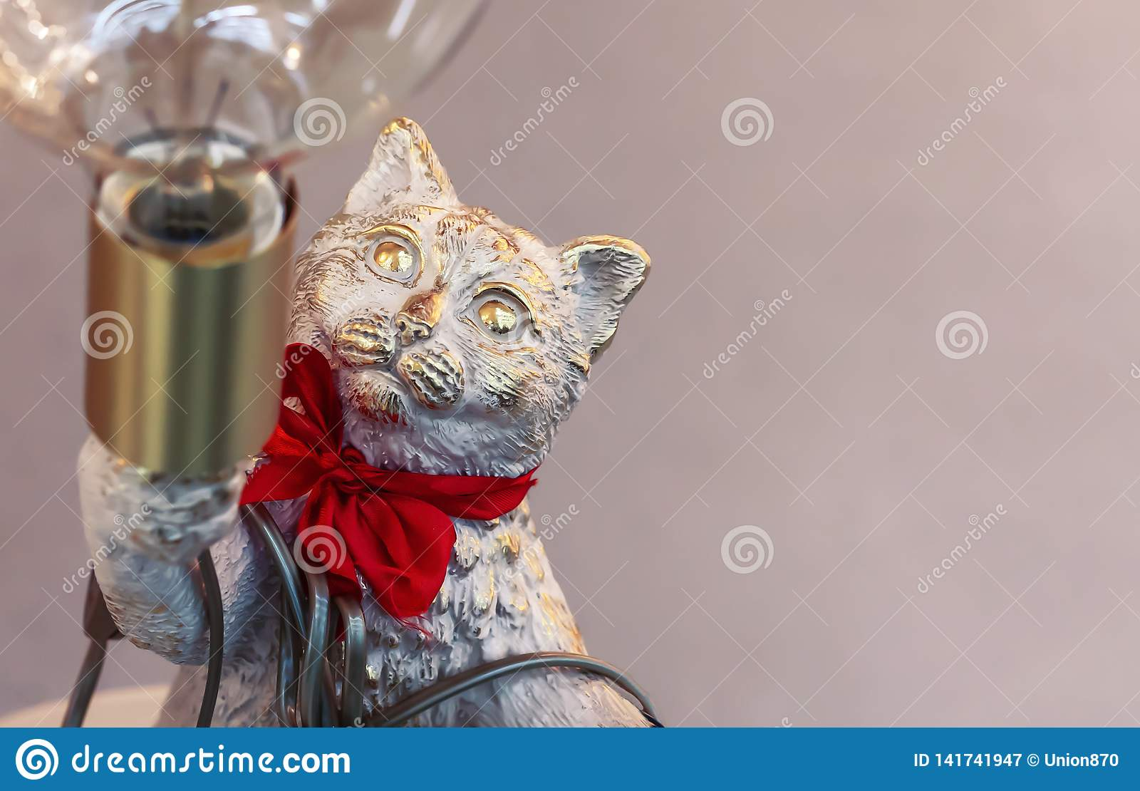 Bronze statuette of a cat with a lamp