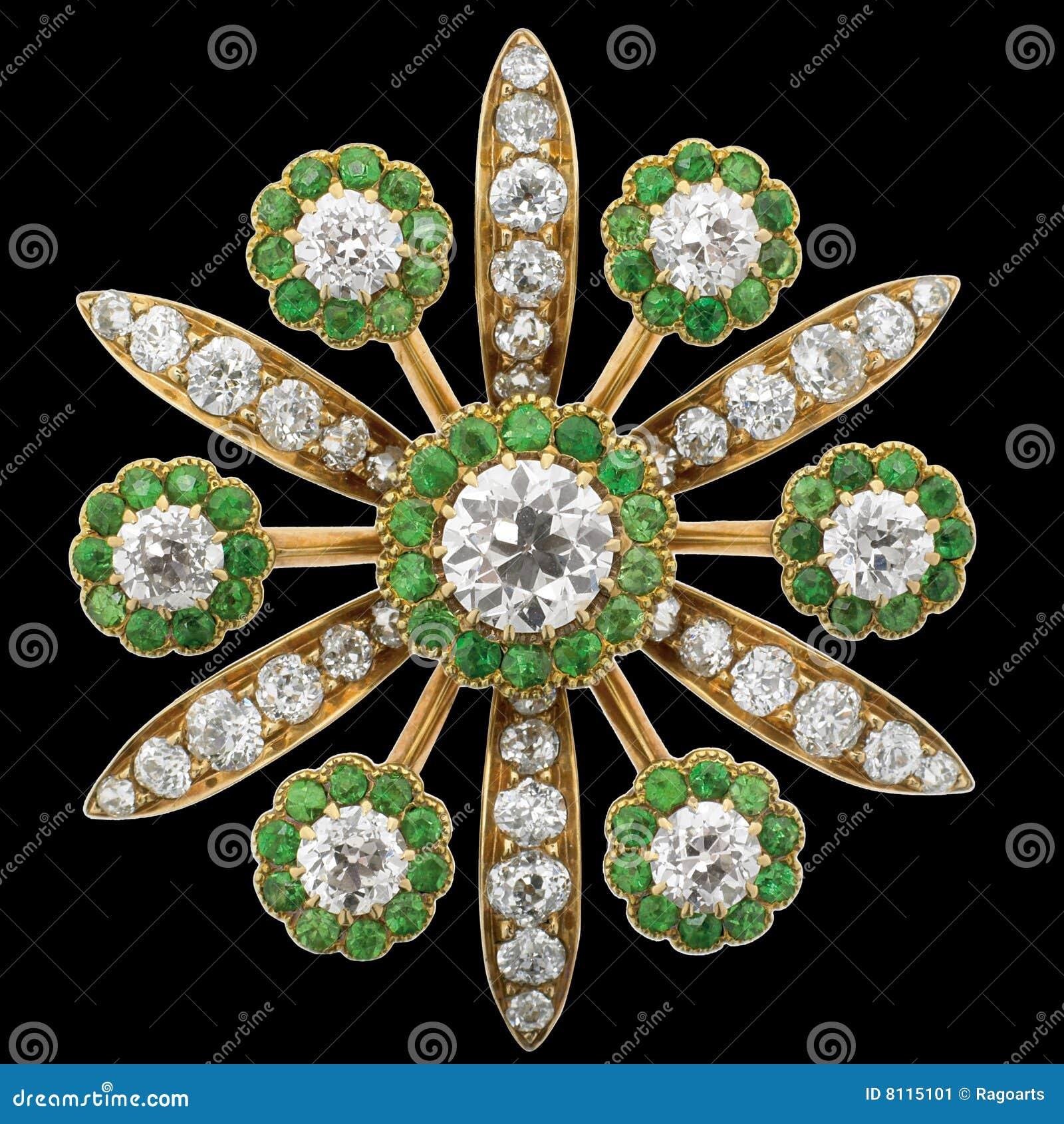Brooch do diamante com esmeraldas