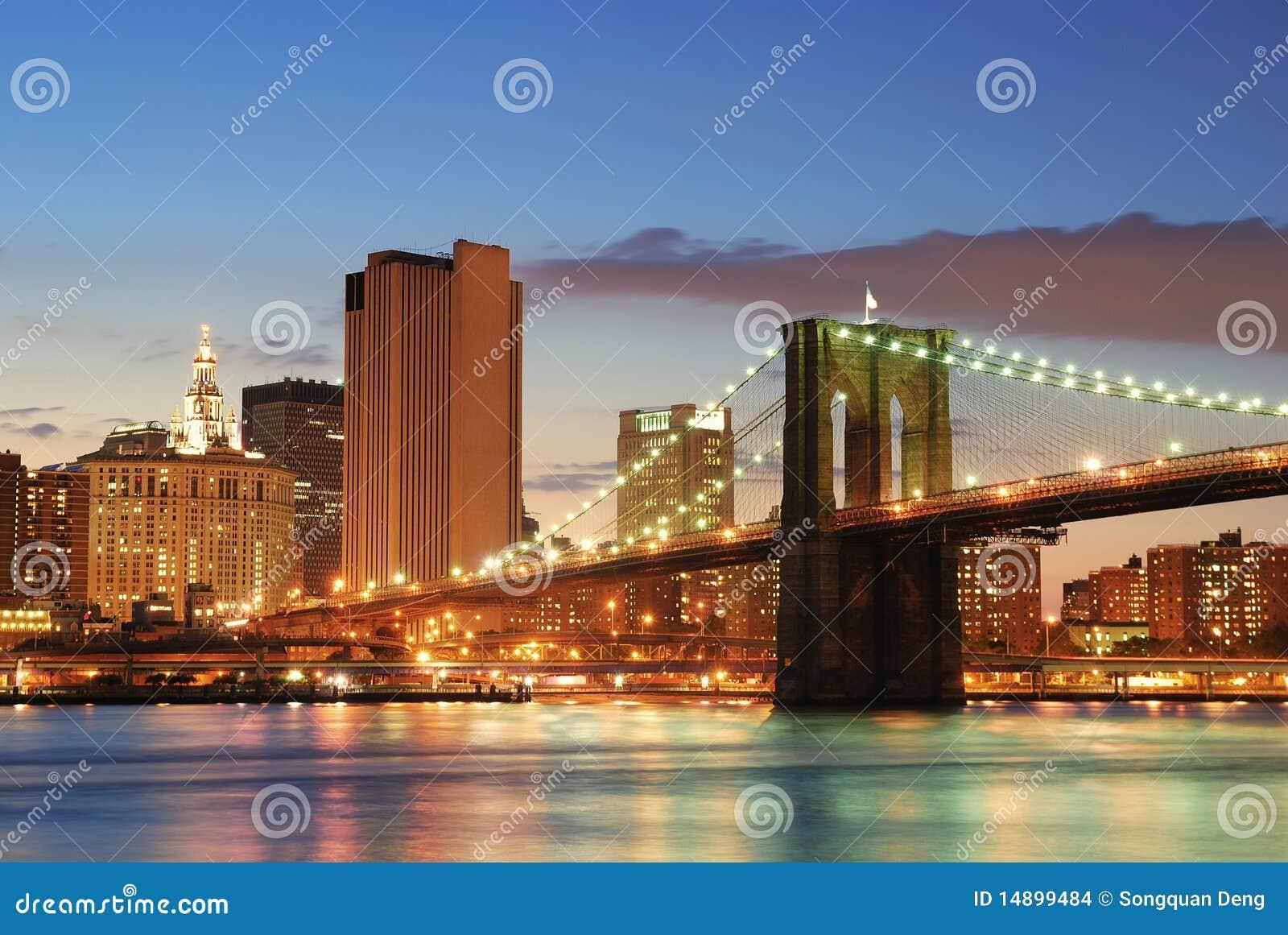 New york city manhattan skyline and brooklyn bridge at dusk over