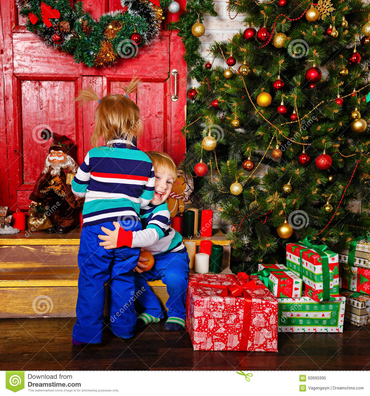 download brother hugging his sister near christmas tree stock image image of cheerful