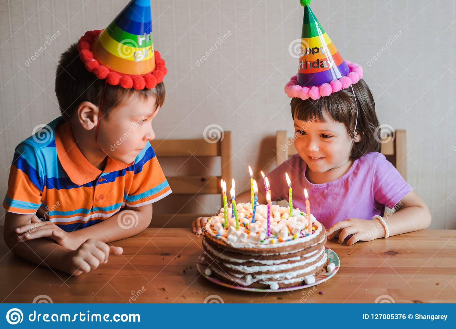 Wondrous Brother And Sister Eating A Birthday Cake With Candles Blowing Out Funny Birthday Cards Online Alyptdamsfinfo
