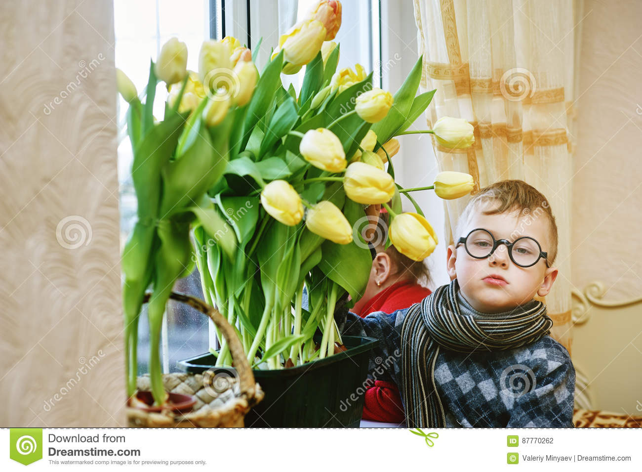 Brother and sister with flowers tulips in the window stock photo download brother and sister with flowers tulips in the window stock photo image of izmirmasajfo