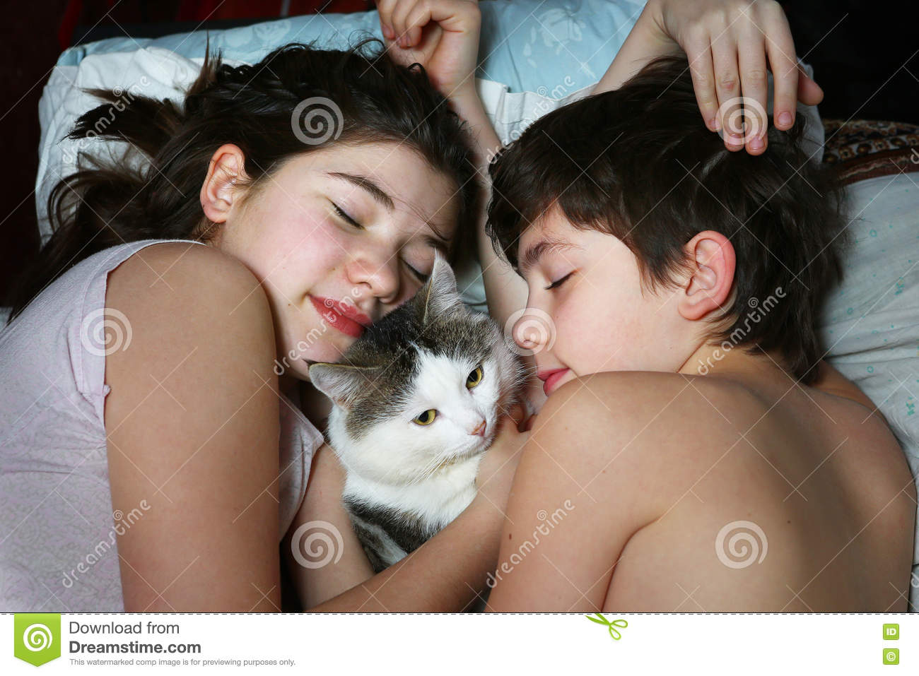 Brother Sister Lay With Cat Close Up Portrait