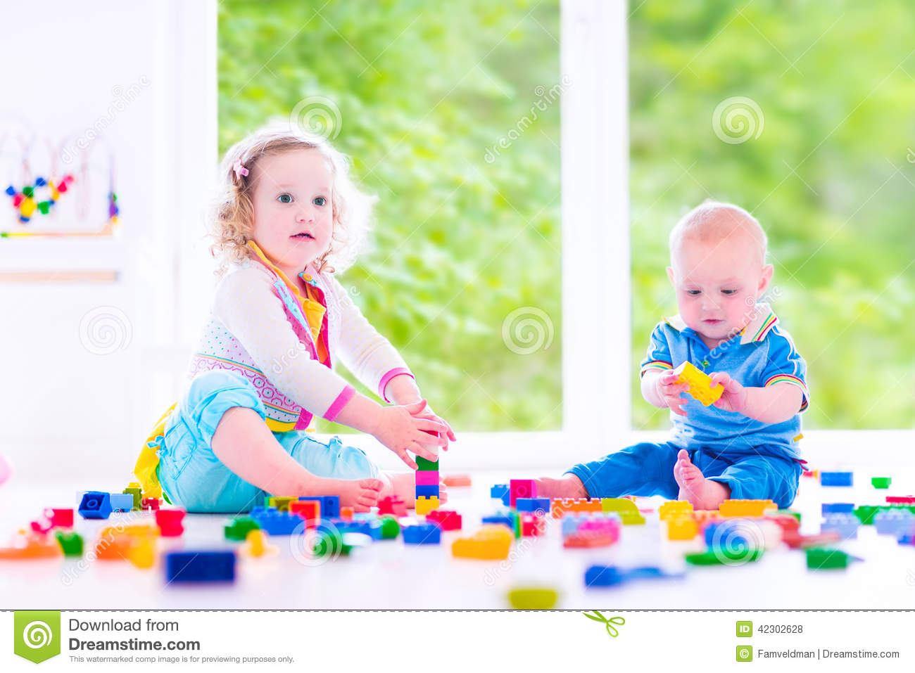 Brother And Sister Playing With Colorful Blocks Stock