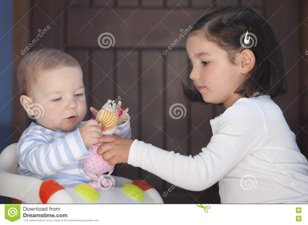 brother and sister playing with dolls. sex stereotyping overcome