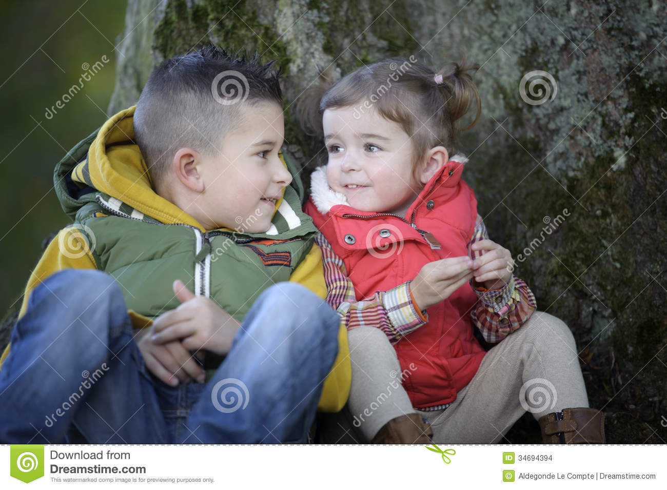 Brother And Sister Talking To Each Other Outdoors Stock Images - Image 34694394-1899