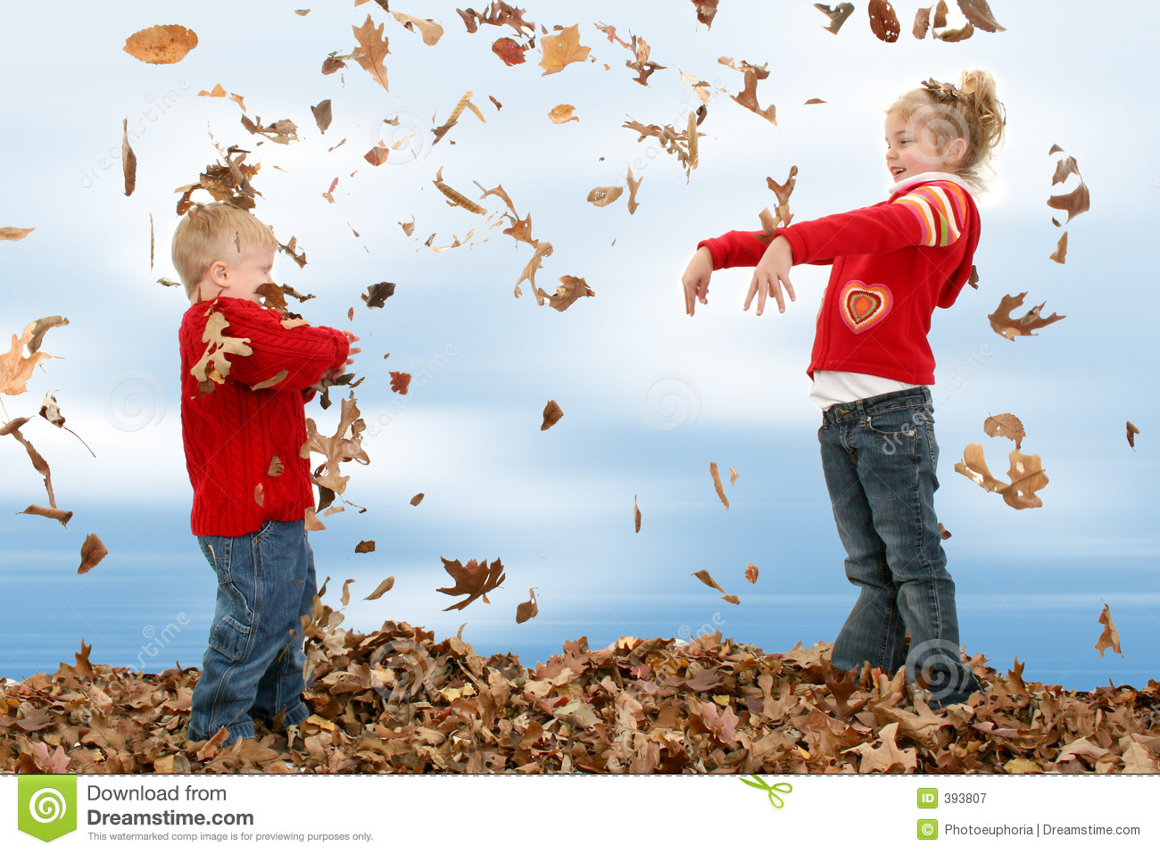 Brother and Sister Throwing Leaves