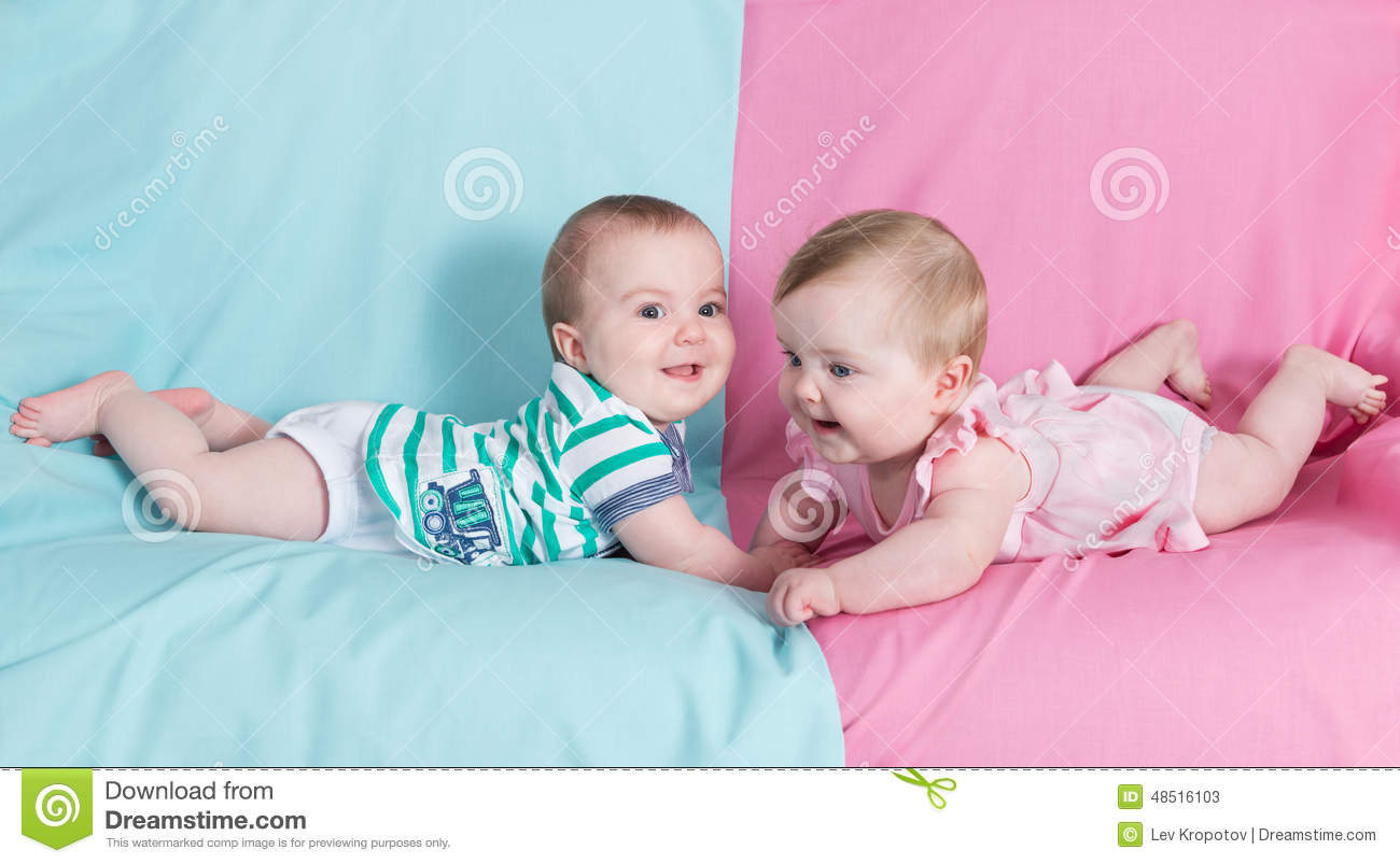 8e1e5486bb8cb5 Brother and sister - twins babies girl and boy on pink and blue background