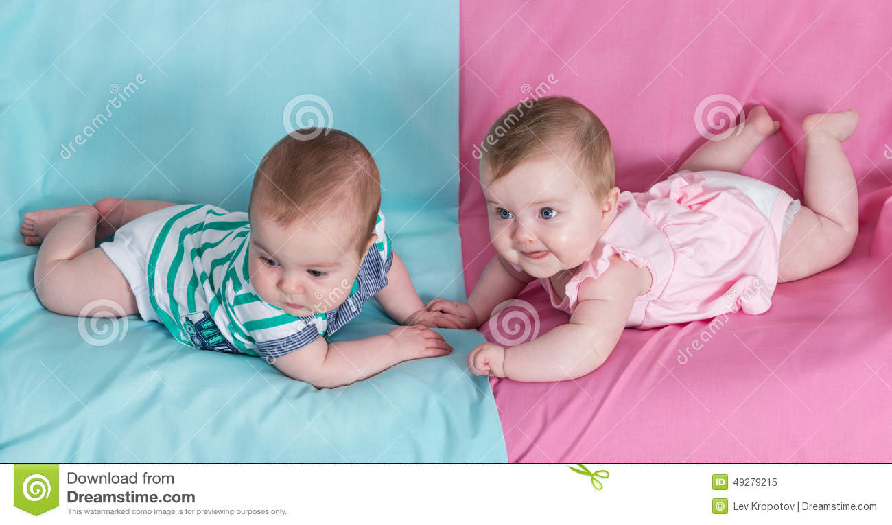 91b78e7eb02822 Brother and sister - twins babies girl and boy on pink and blue background.  More similar stock images
