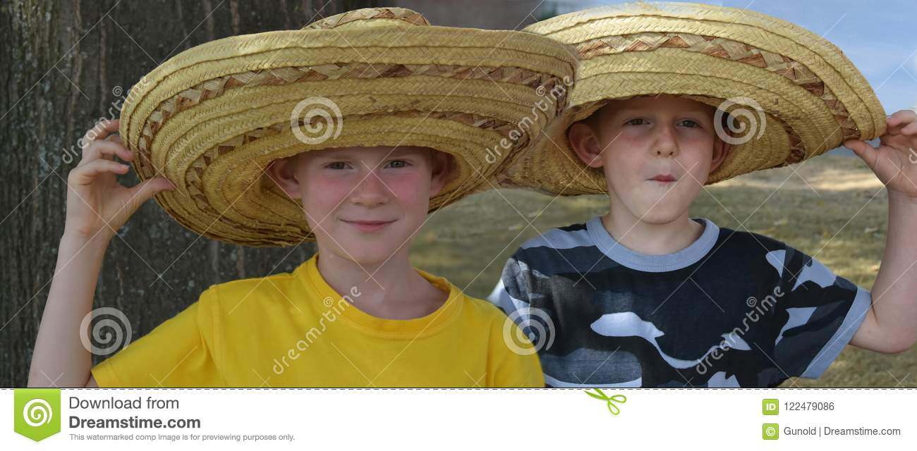 Brothers with big mexican straw hats