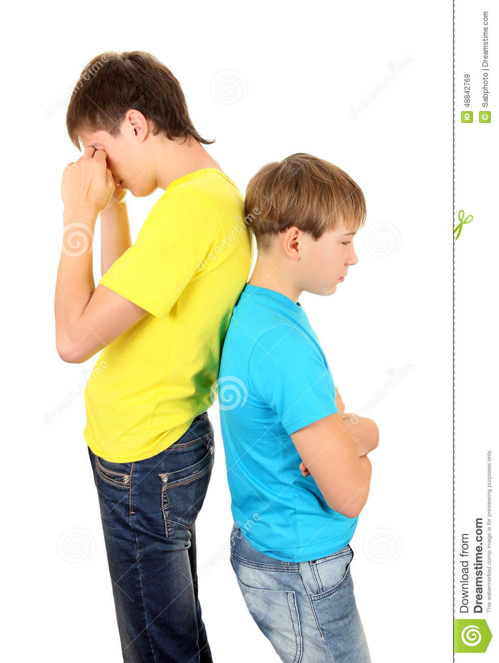 Sad Teenager and Kid stand Back to the Back on the White Background.