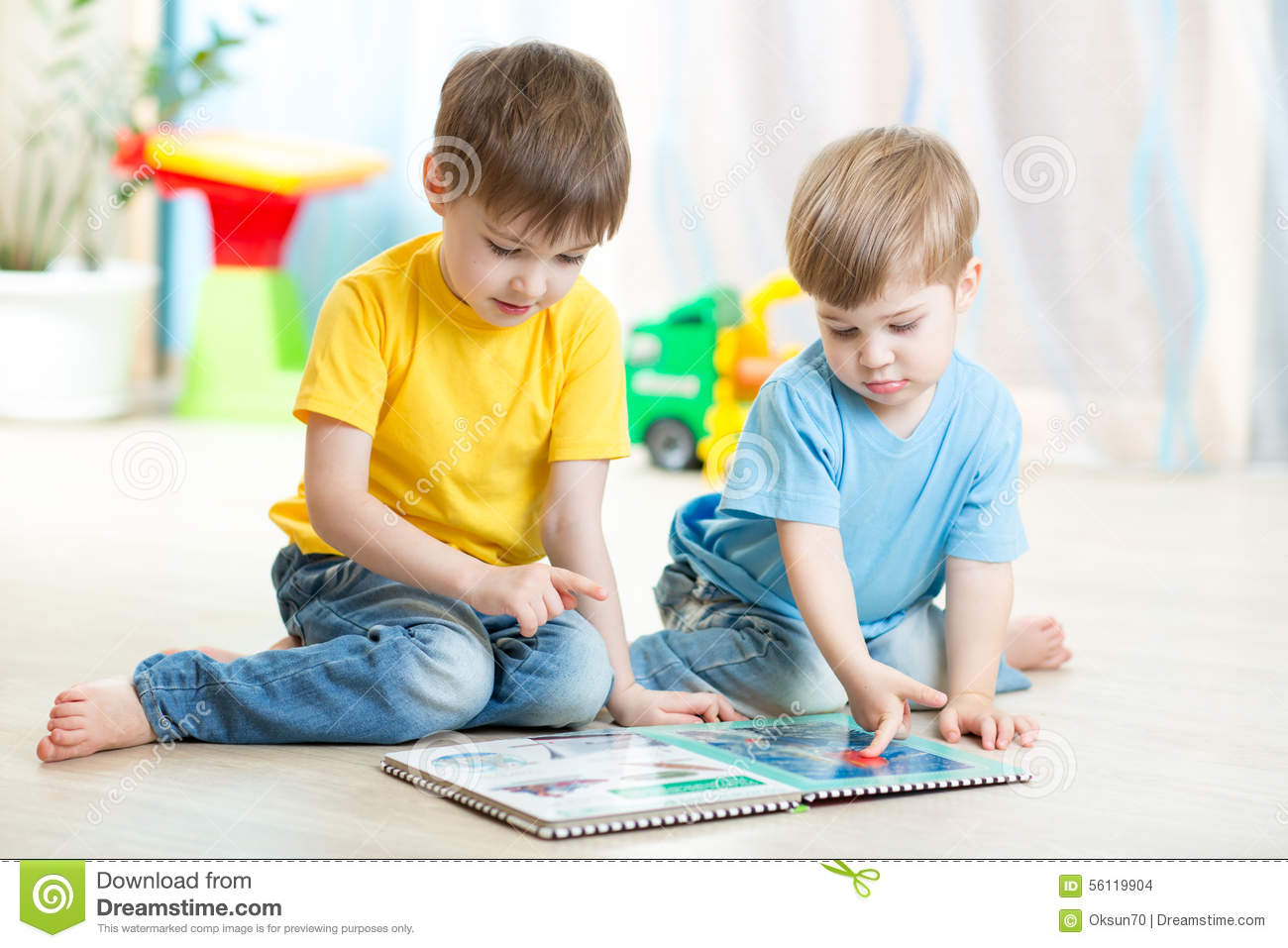 Brothers Kids Reading Book Together At Home Stock Photo ...