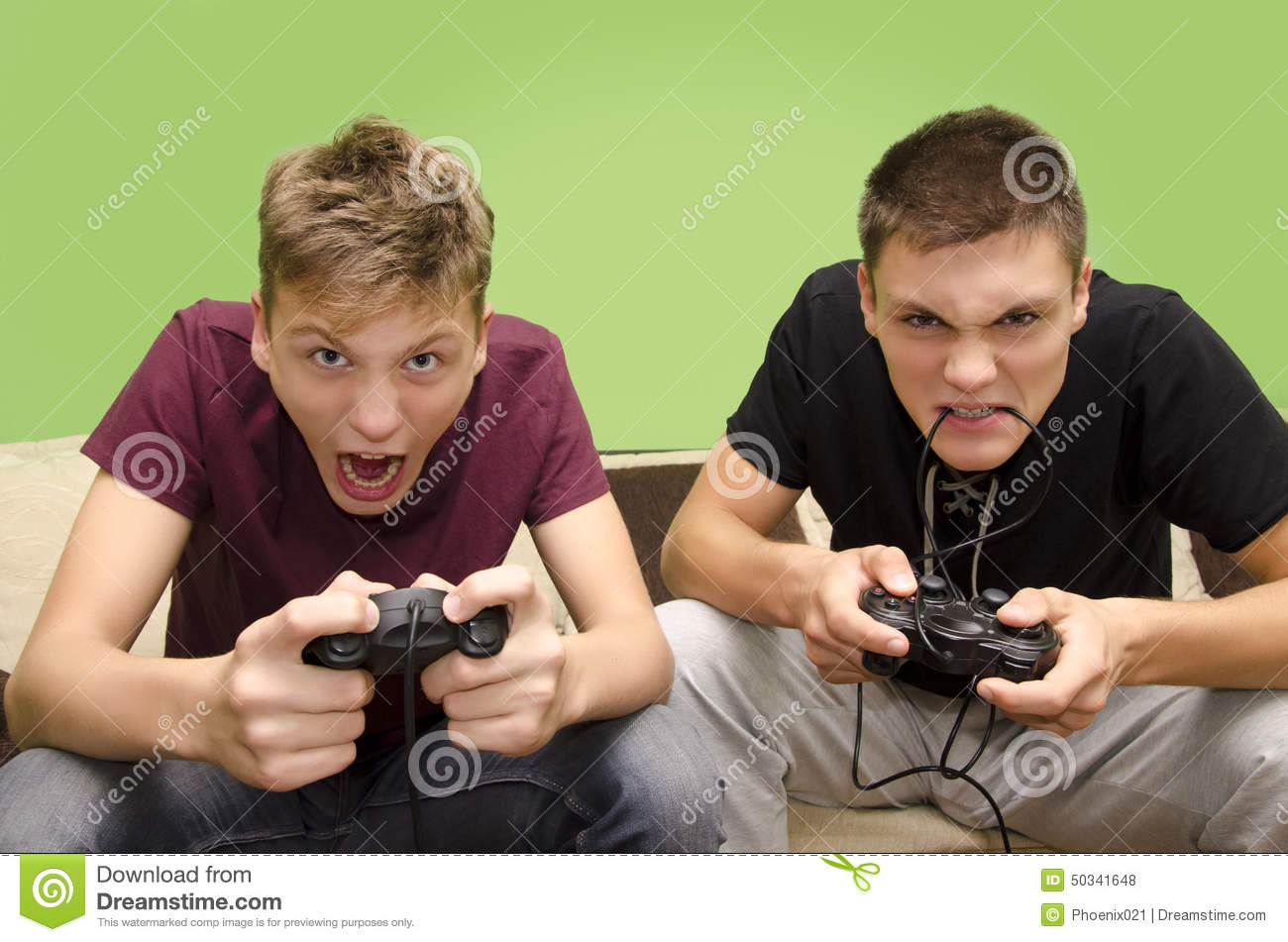 brothers-playing-video-games-funny-selective-focus-younger-brother-two-teenager-very-intense-yelling-biting-joystick-cable-50341648.jpg