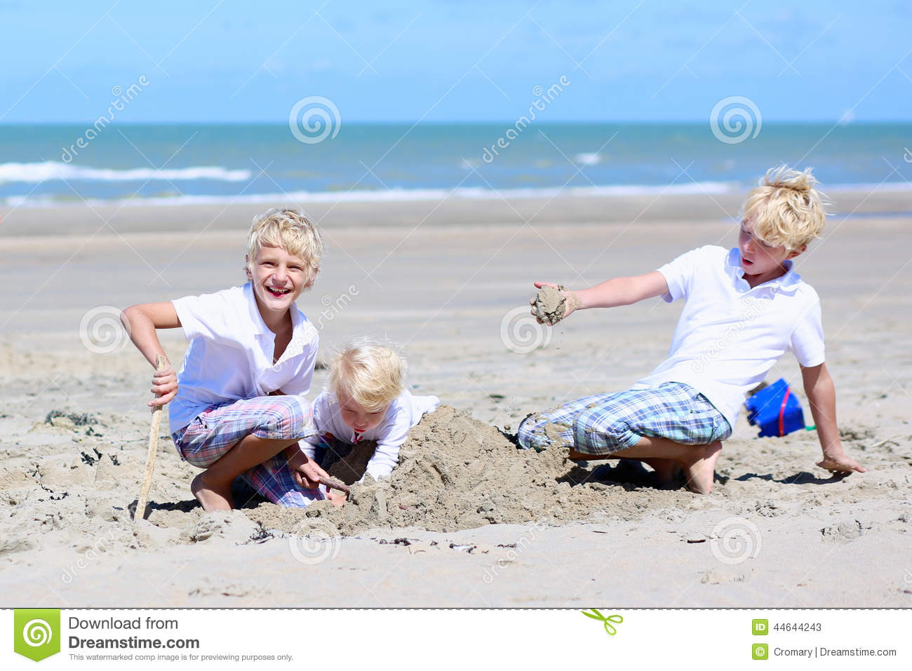 Brothers And Sister Playing On The Beach Stock Image -9357