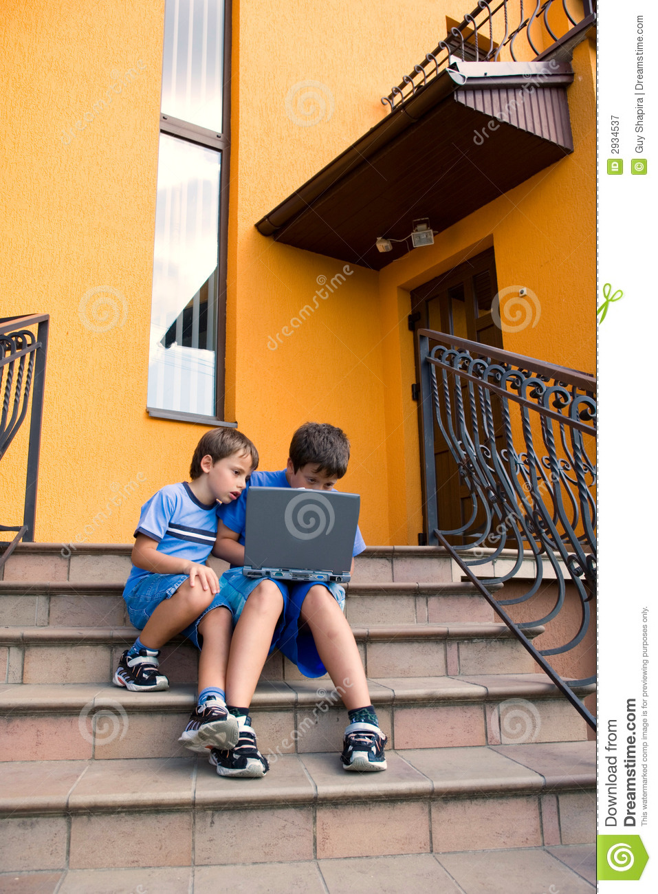 Brothers study on computer