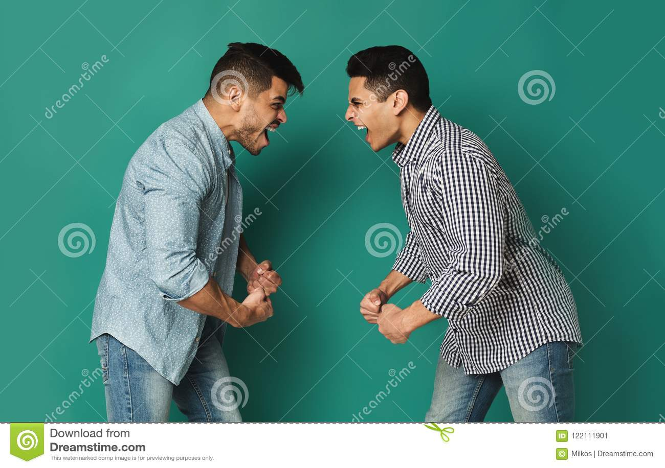 Two Arab Man Shouting At Each Other At Studio Background Stock Image