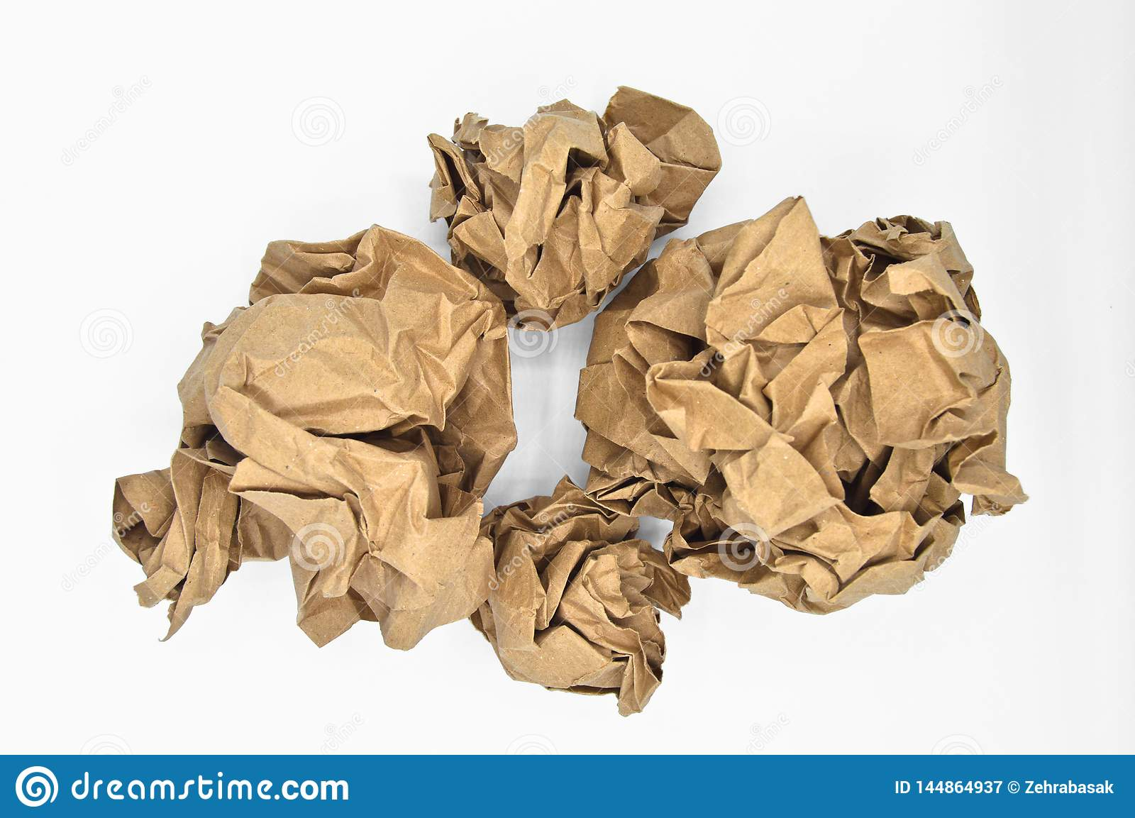 Brown and beige crumpled paper ball.