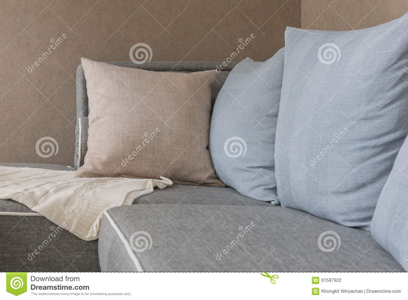 Brown and blue pillows with blanket on modern grey sofa stock photo image 61587922 - Brown sofa with blue pillows ...