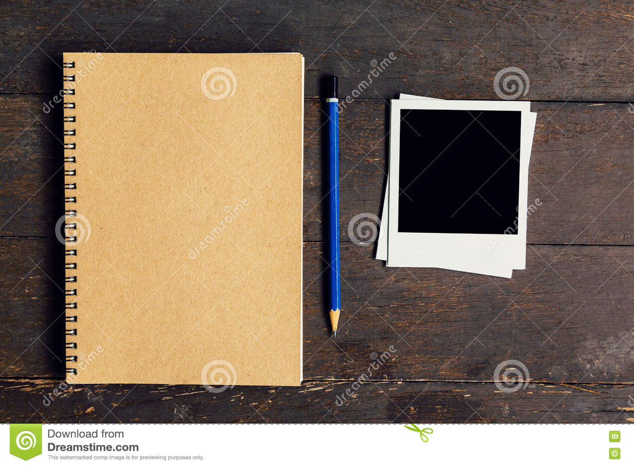 Brown book and pencil with frame photo on wood table background