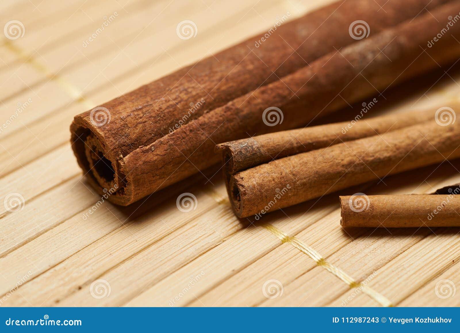 Cinnamon sticks on a bamboo background