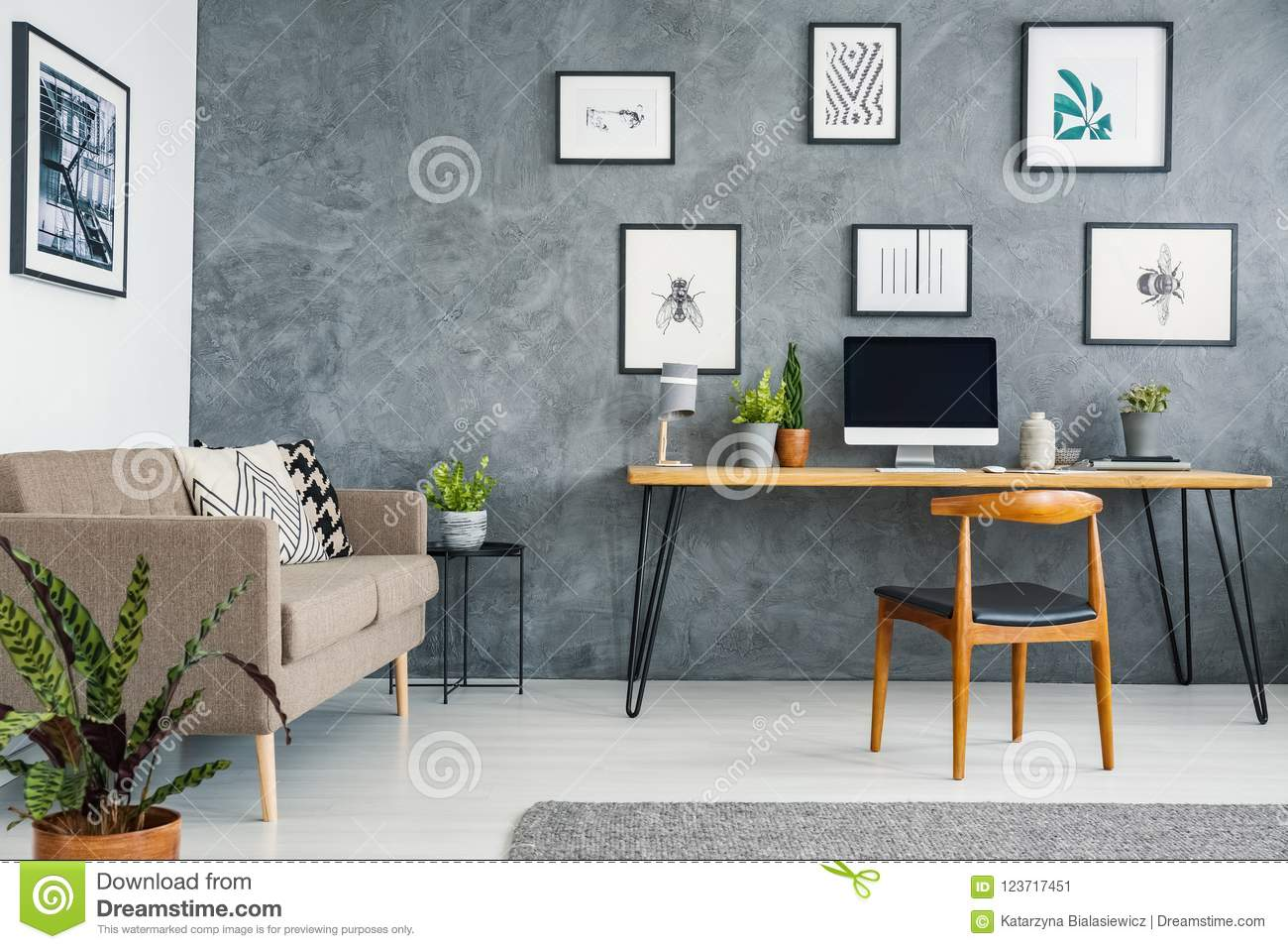 Brown Couch Next To Wooden Desk And Chair In Grey Freelancer