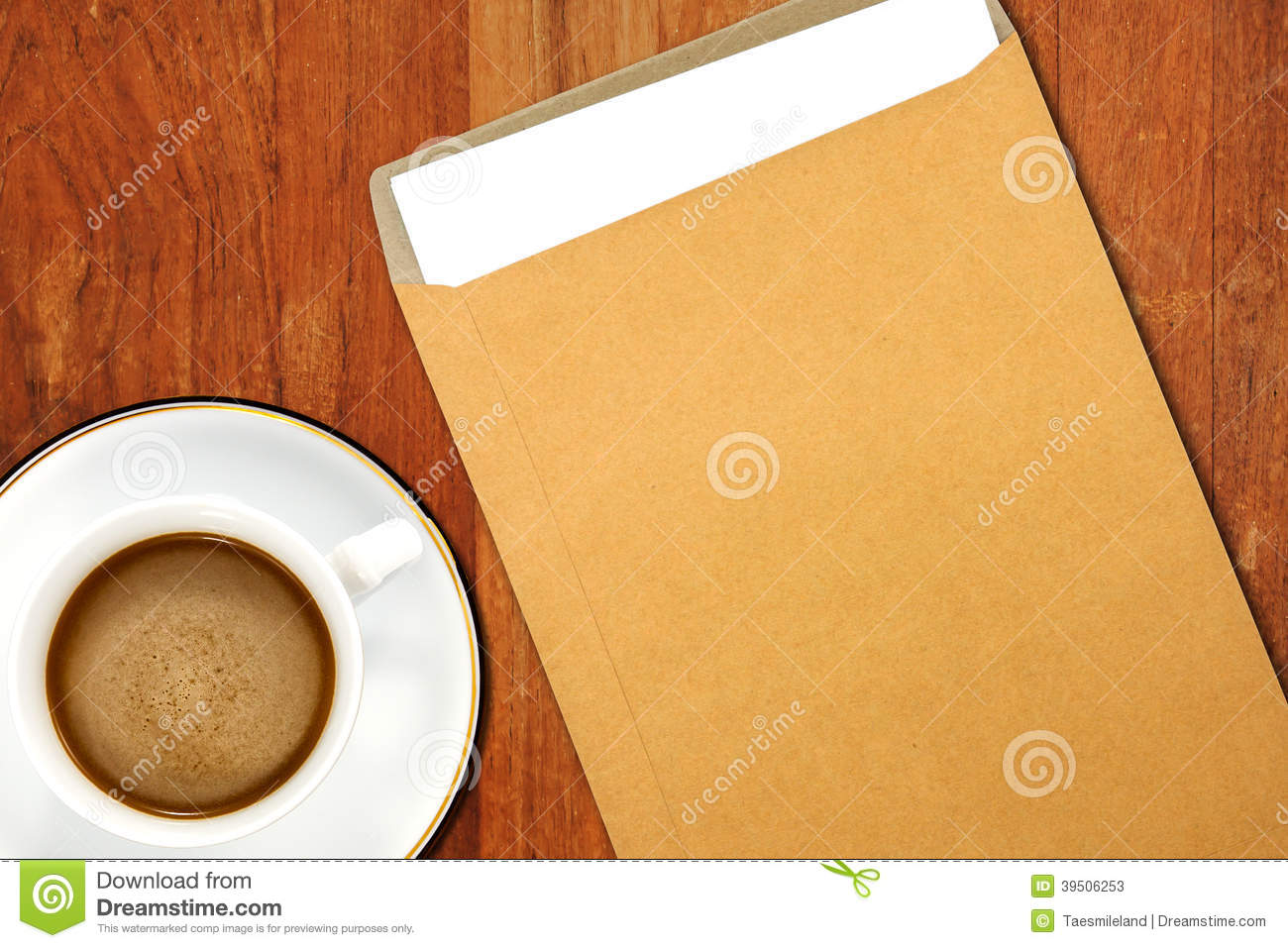 Brown Envelope document and a white coffee cup