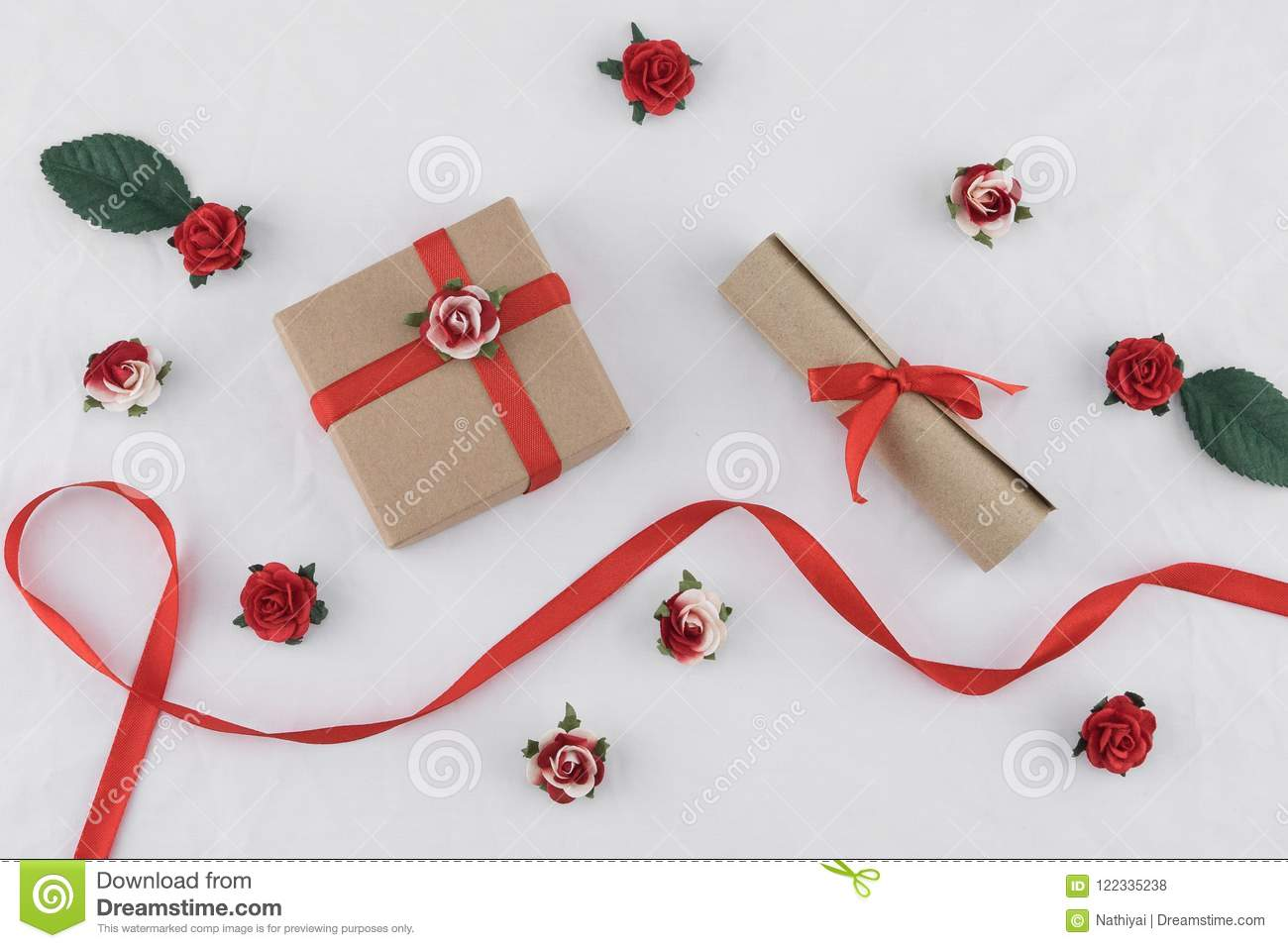 Brown Gift Box And Scroll Decorate With Red Rose Paper Flowers Stock
