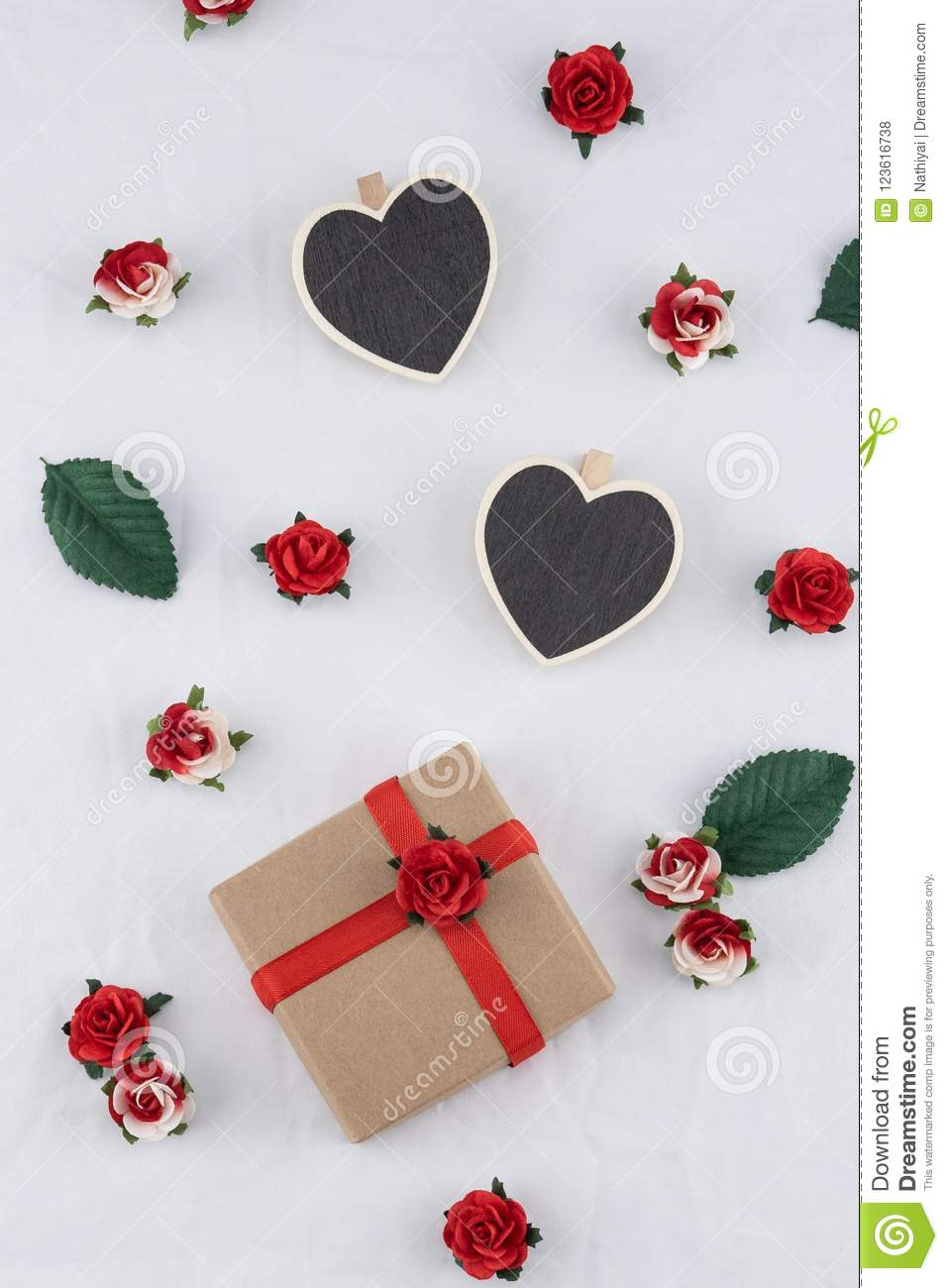 Brown gift box and tiny heart blackboard stock photo image of brown gift box and tiny heart blackboard decorate with red rose paper flowers on white fabric mightylinksfo