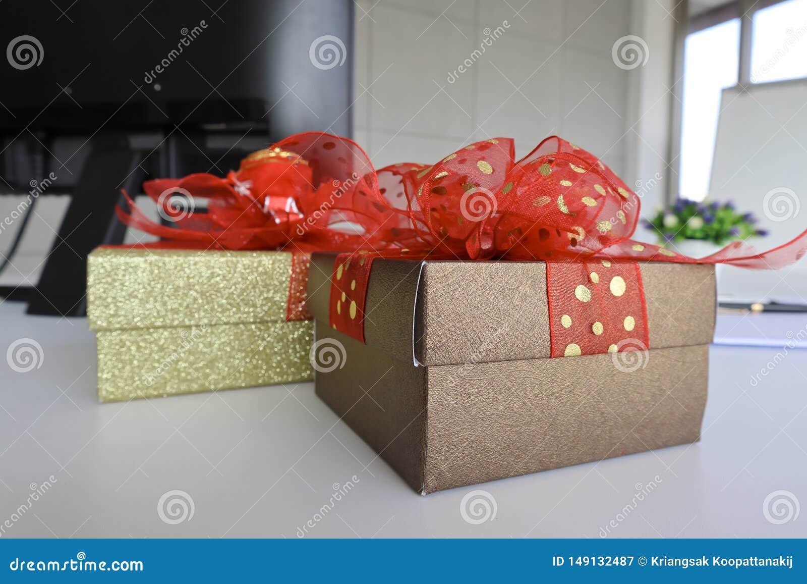 Two gift boexes on the white desk
