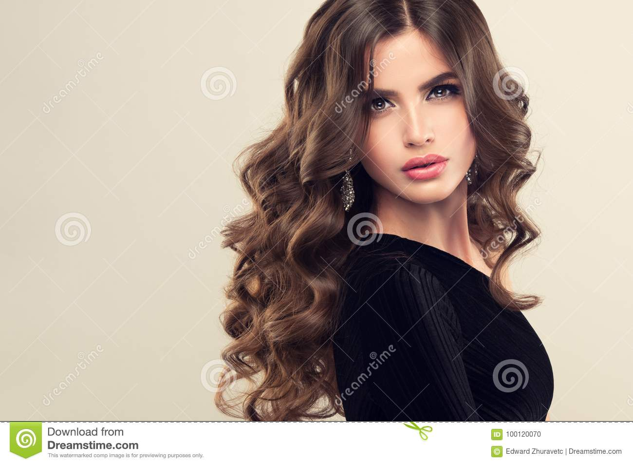 brown haired woman with voluminous, shiny and curly hairstyle.frizzy