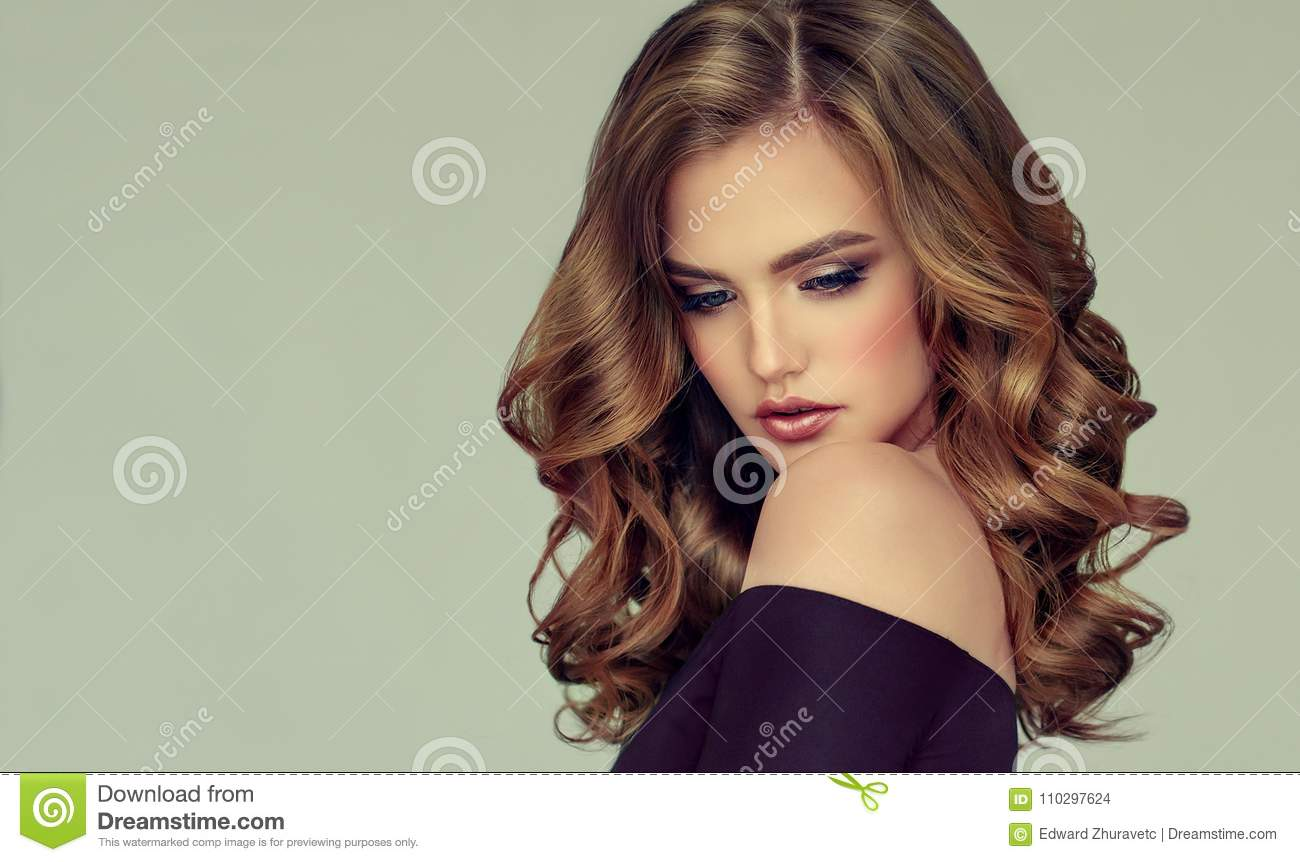 Brown Haired Woman With Voluminous, Shiny And Curly Hairstyle.Frizzy ...
