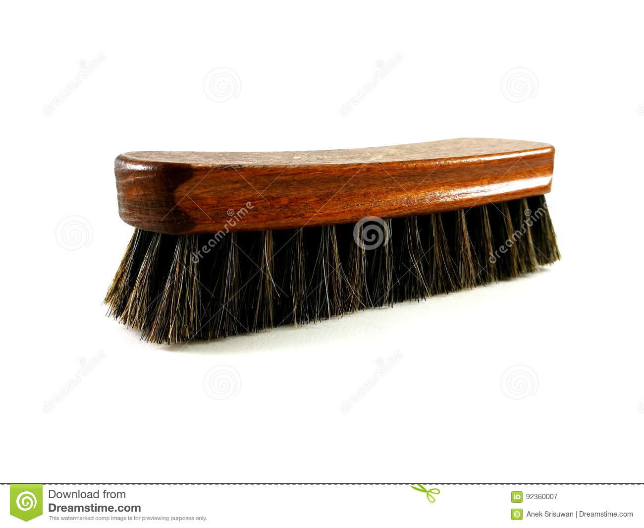 Brown horsehair brush for cleaning.