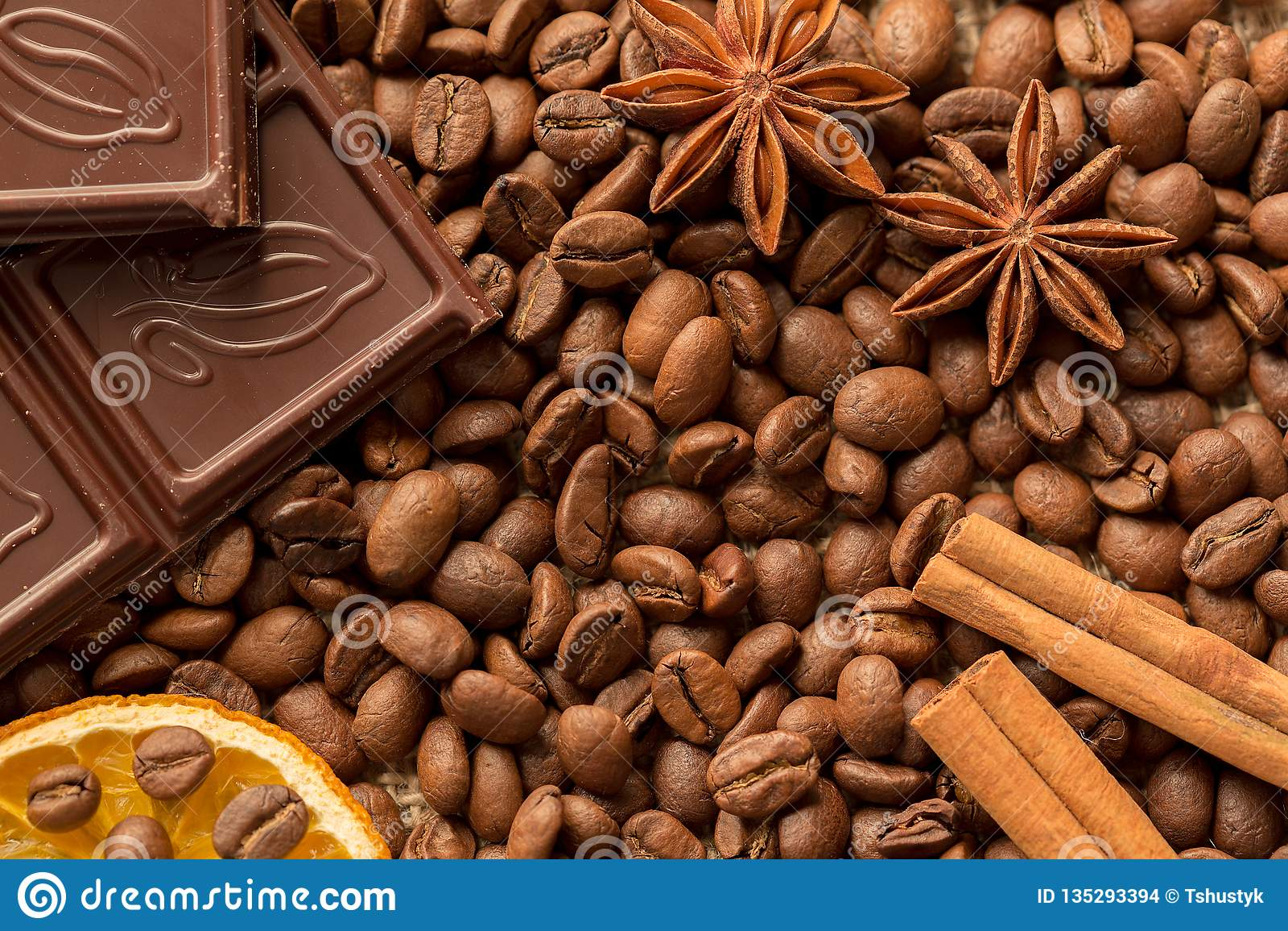 Brown ingredients macro: anise star, cinnamon sticks and coffee beans. Top view