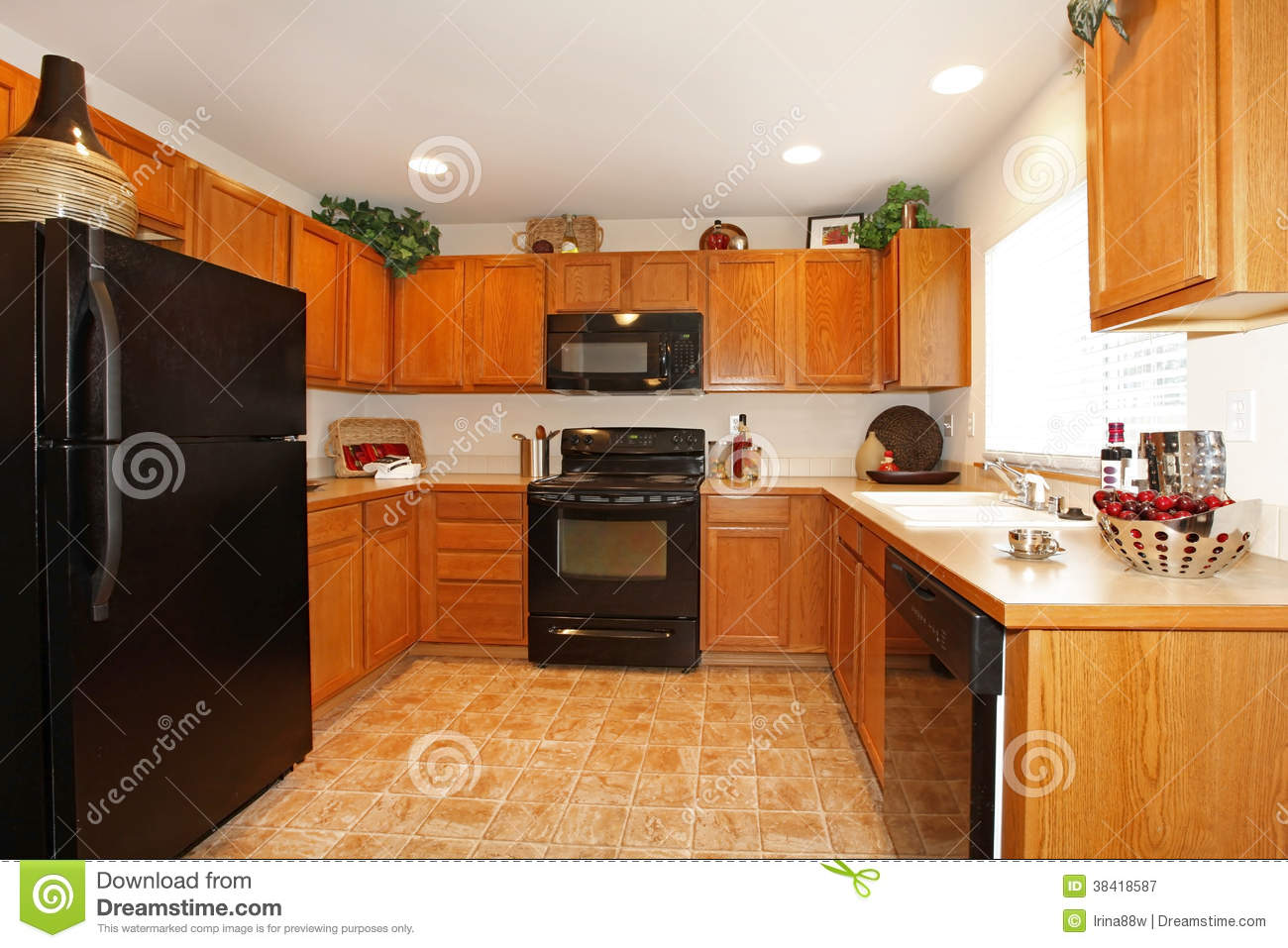 Brown kitchen cabinets with black appliances royalty free for Brown kitchen cabinets with black appliances