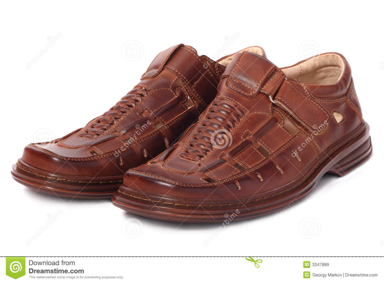 Pair of brown leather shoes, isolated on white background