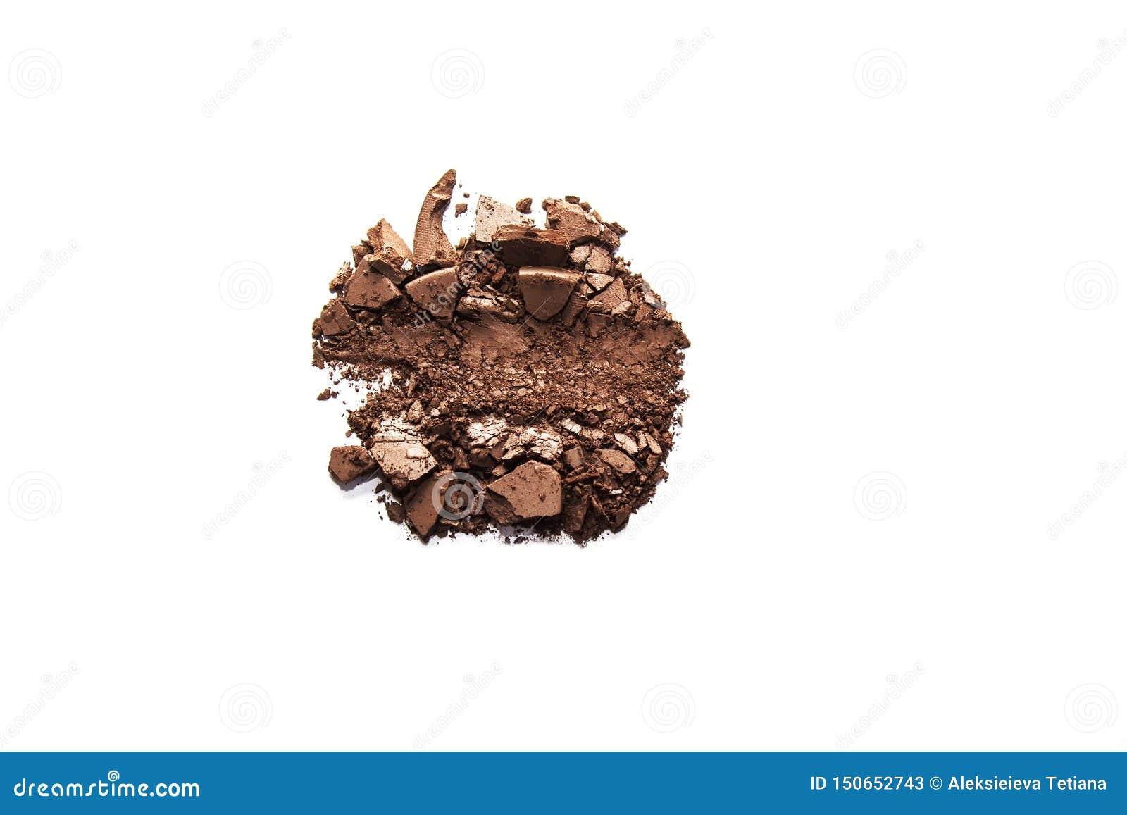 Brown-Lidschatten zerquetschte die Proben, die auf weißem Hintergrund lokalisiert wurden