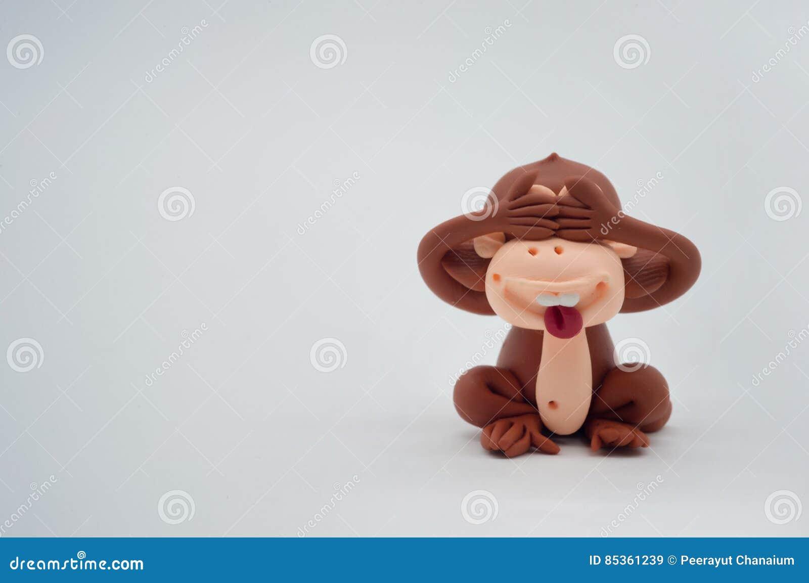 Brown monkey doll close eyes on white background