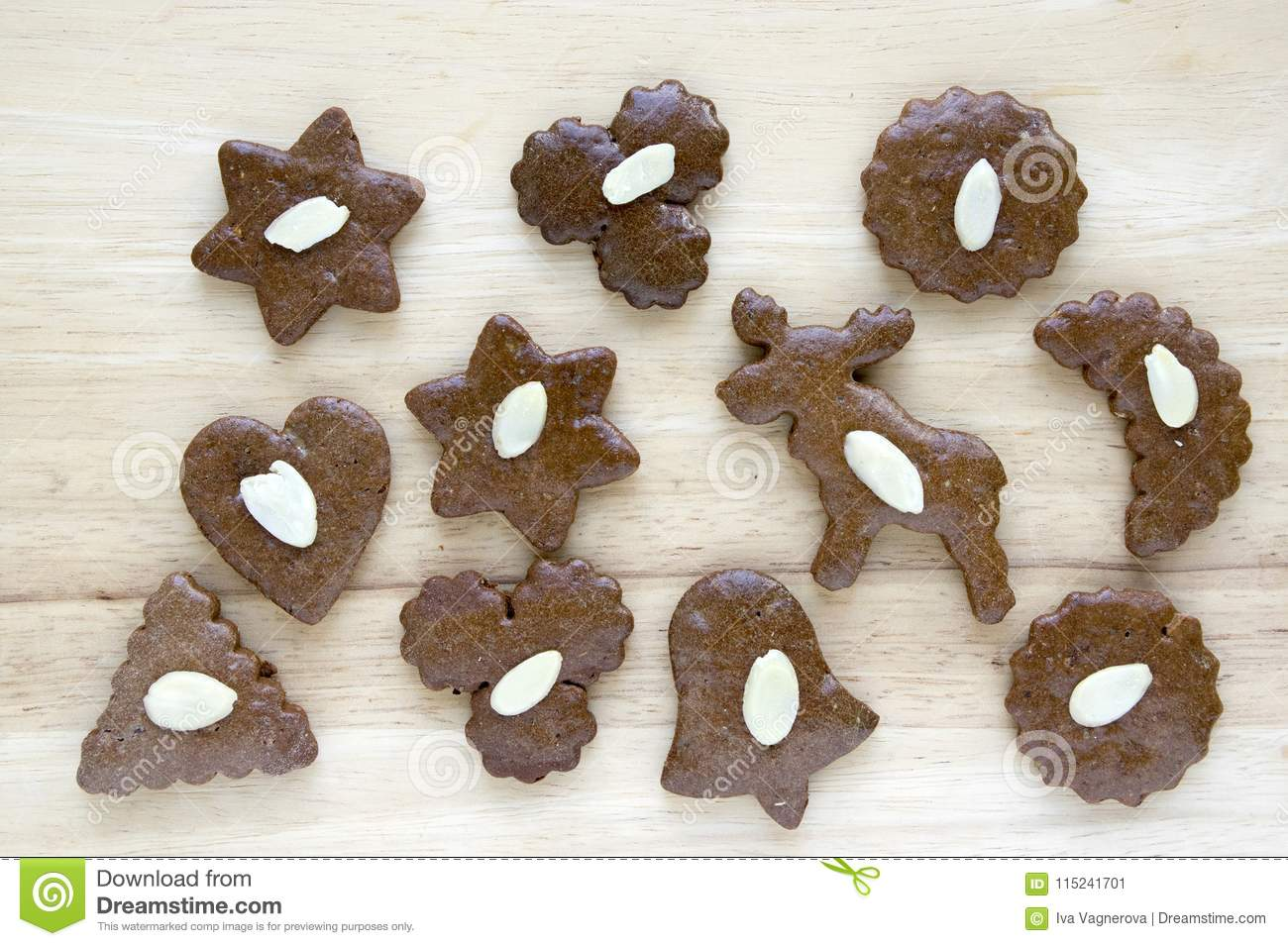 Brown Moravian Dark Gingerbreads With Sliced Almonds On Wooden Table