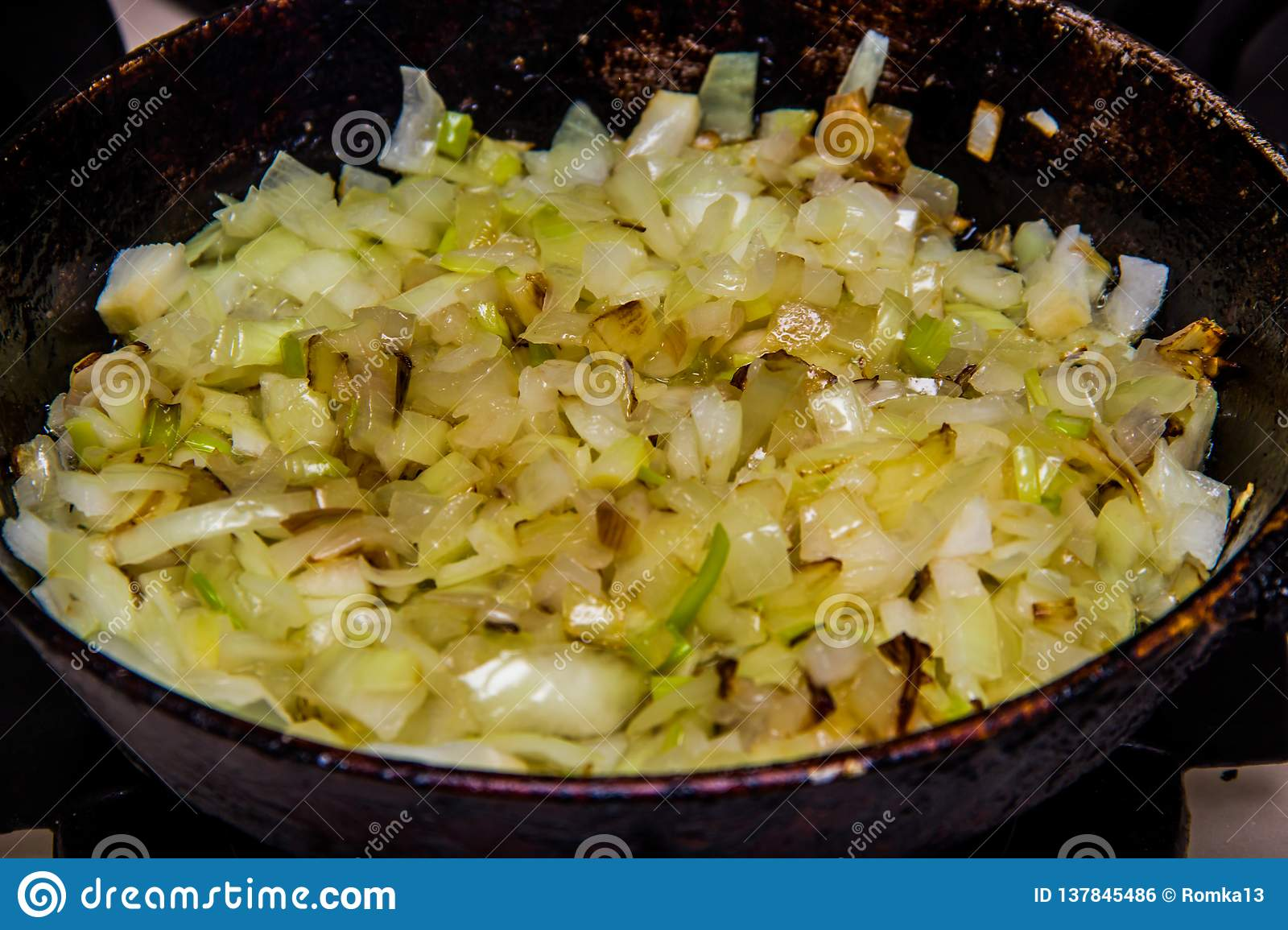 Brown onions fried in a pan