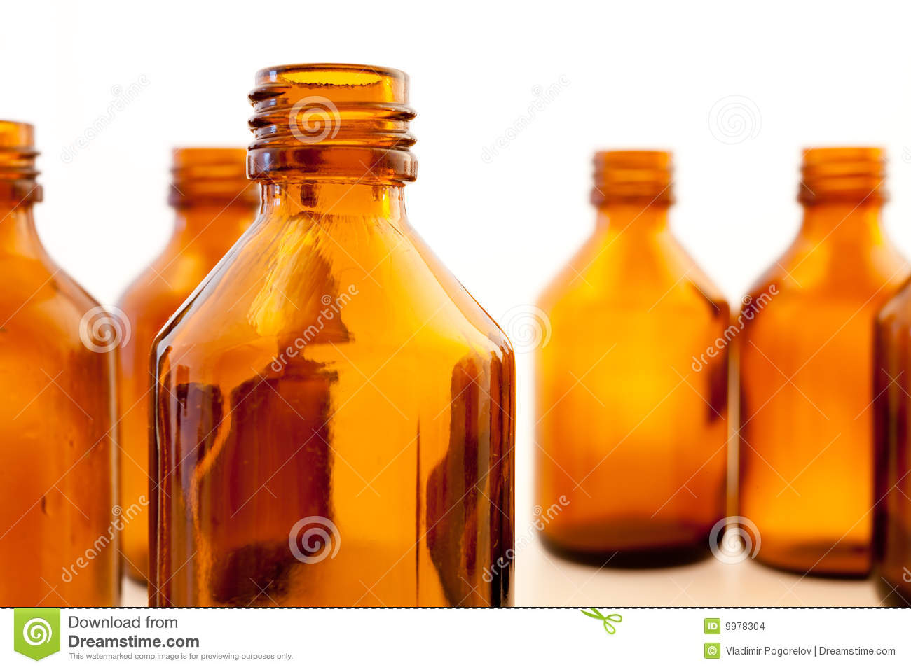 Several empty pharmaceutical bottles without labels.