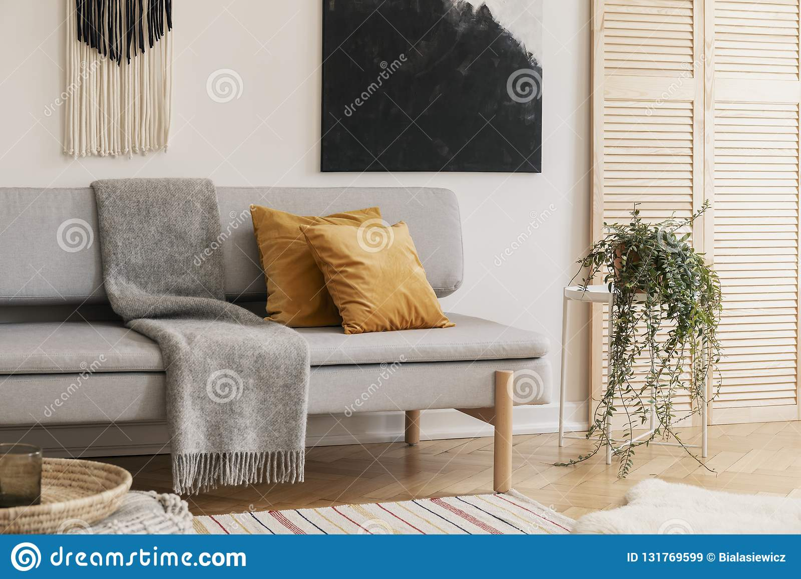 Pleasing Brown Pillows And Grey Blanket On Couch In Living Room Stock Cjindustries Chair Design For Home Cjindustriesco