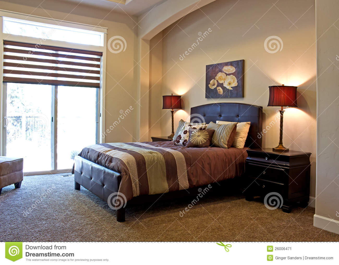 Neutral color luxury bedroom in brown and rust colors photographed in