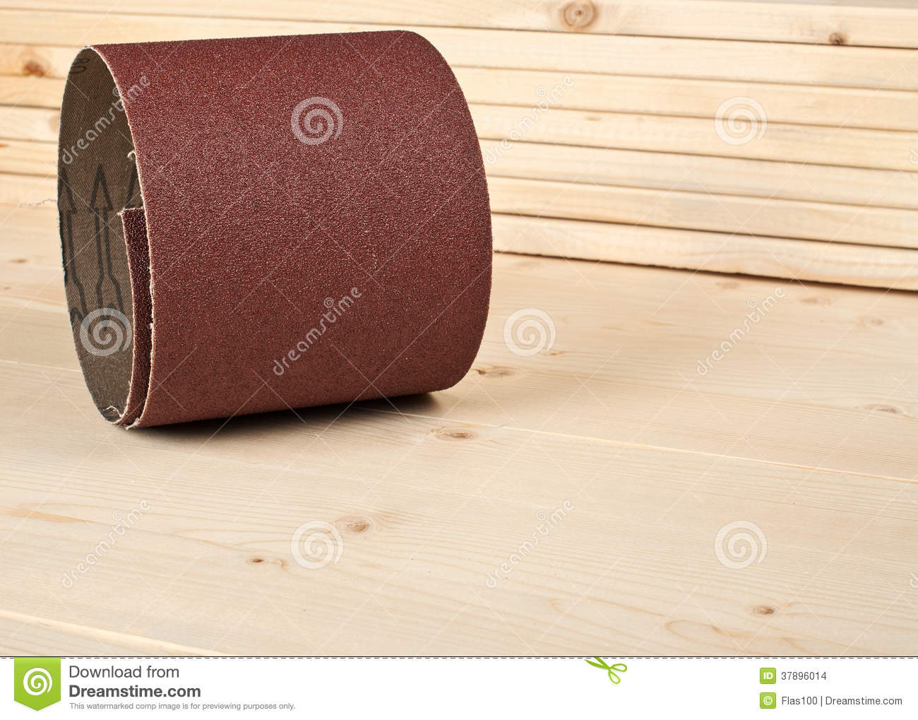 Brown sandpaper on wooden planks