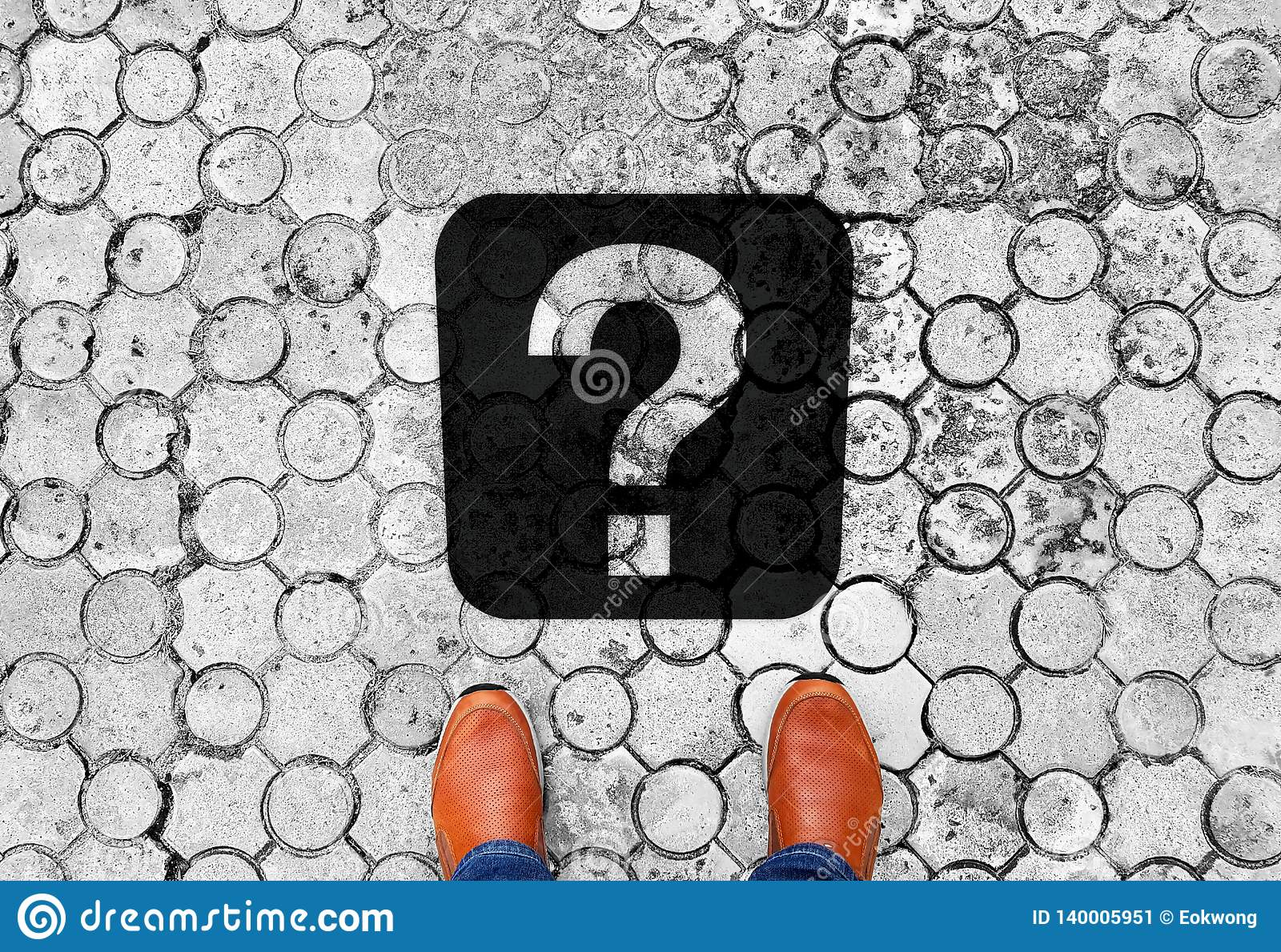 Brown shoes standing on the floor with question mark - meaning of life - next travel destination